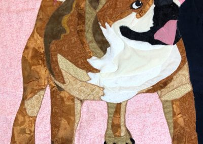 fabric pet portrait of brown and white dog being hugged by a girl