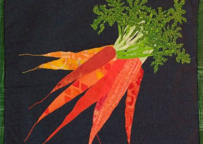 Fabric wall hanging of carrots