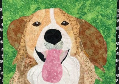 memorial pet portrait: brown dog with green background on fabric wall hanging