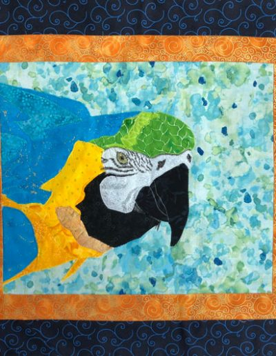 parrot on fabric wall hanging