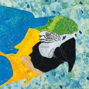 Close up for head and shoulders of blue and yellow McCaw parrot as fabric wall hanging art piece for sale