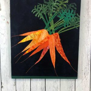 Fabric carrots on canvas