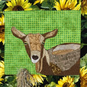 closeup of goat fabric wall hanging gift for goat lovers