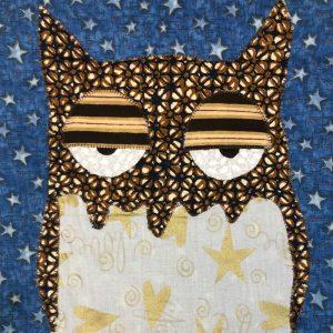 sleepy brown owl wall hanging with stars
