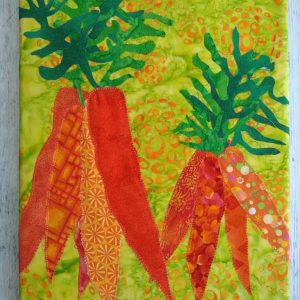 bright yellow and orange fabric carrots on canvas