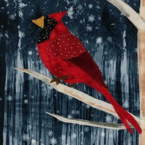 Cardinal in winter closeup of fabric picture