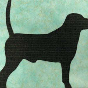 Fabric dog on canvas closeup