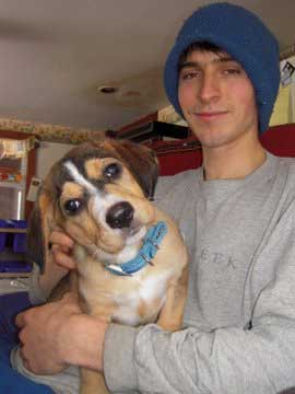 Ryan holds Echo as a puppy