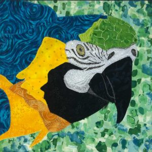 Yellow, blue, and green Macaw parrot as fabric wall hanging