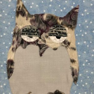 Sleepy tan owl with blue background fabric wall hanging